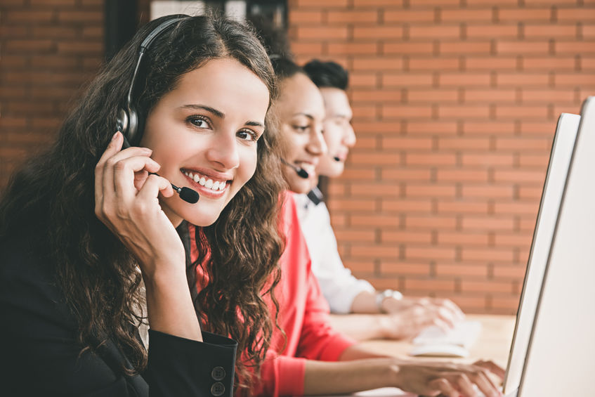 Smiling Beautiful Woman Telemarketing Customer Service Agent Working In Call Center Office With Her Multiethnic Team